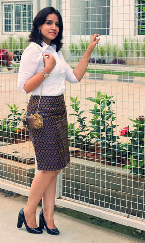 Limit 550 500 suede clutch with brocade skirt and white shirt  1